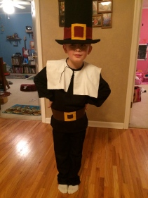 My little Pilgrim. Black pants, shirt, hat, collar (made of cut fabric and glued on tie), and finally the belt (made of vinyl, felt for buckle, and velcro to keep together).